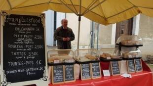 British stallholder sells 'franglais' food on Eymet market, in Dordogne, southwest France