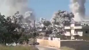 Một vị trí trong tỉnh Idlib, Syria, bị oanh kích. Hình ảnh trích từ một video đăng trên mạng hôm 27/05/2019.