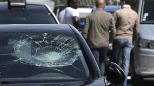 Vehicles were damaged in clashes near Orly airport, 25 June 2015.