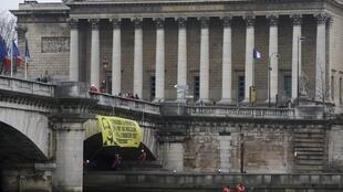 Greenpeace protest near the National Assembly, Paris, 9 March 2015.