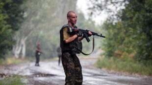 An Ukrainian soldier patrolling in the Donetsk region. 28 August 2014.