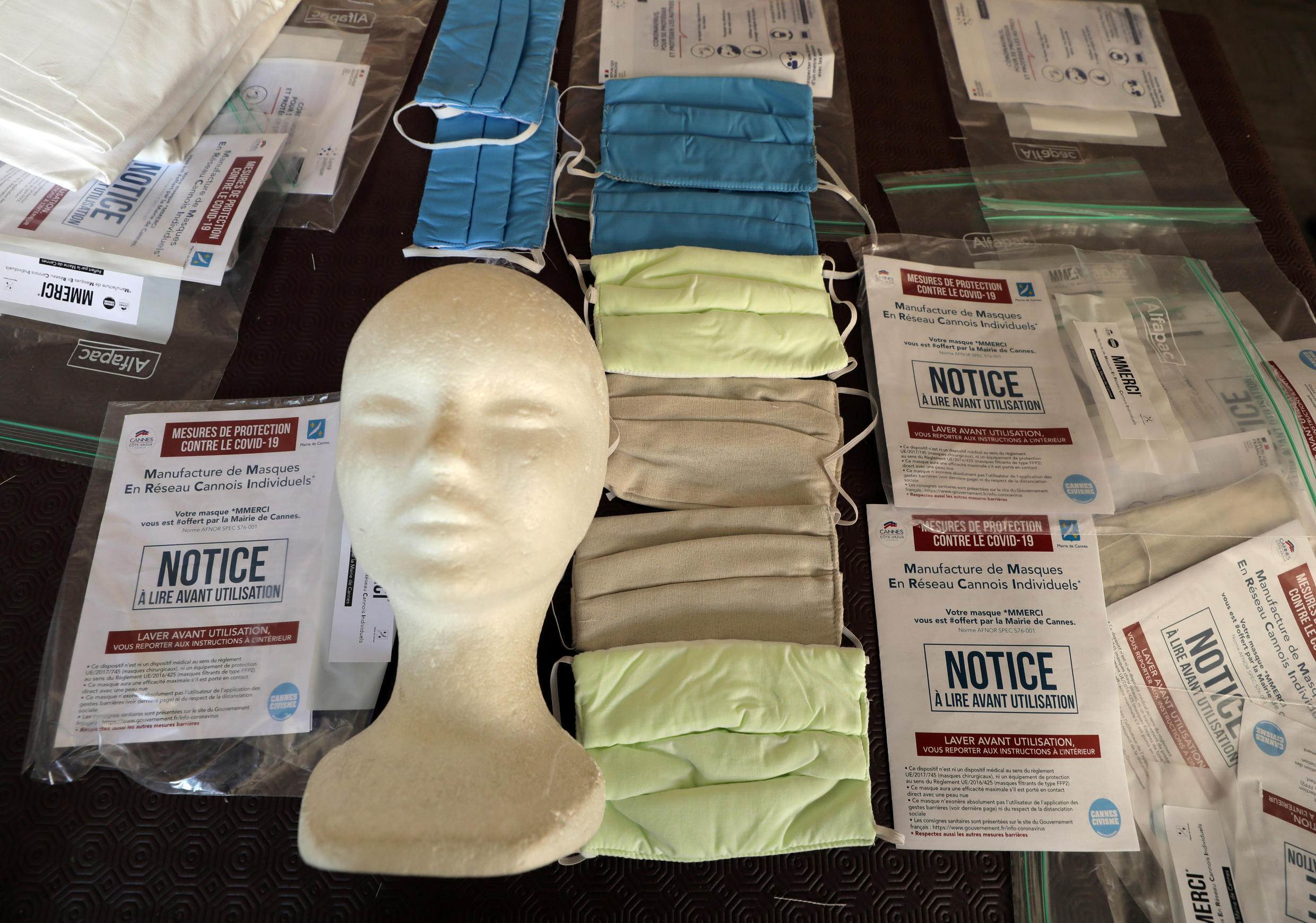 Protective face masks are seen at Aline Buffet's sewing workshop in Cannes, as the spread of the coronavirus disease continues in France, April 8, 2020.