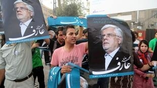 Simpatizantes del candidator reformista Mohammad Reza Aref, el 6 de junio de 2013.