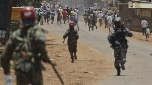Ugandan military police charged after a group of youth throwing stones in Kampala on 18 April