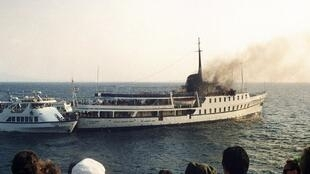 Smoke bellows from the City of Poros after the attack