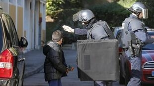 Police on Marseille's Castellane estate after the gunfire in February