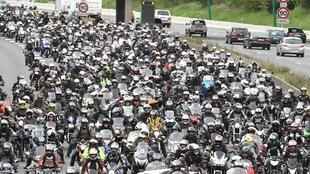 Motorcyclists swamp a road in Toulouse on Saturday