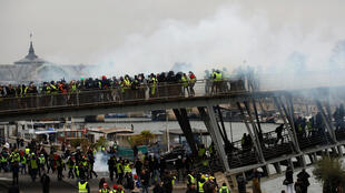 Tear gas was fired at protesters at the Seine riverbank in Central Paris.