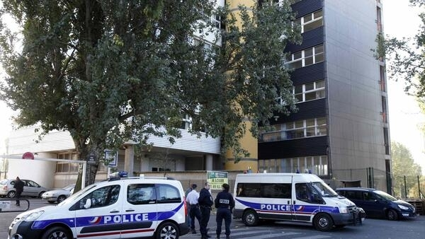 Police posted ourtside Charlie Hebdo's offices on Wednesday