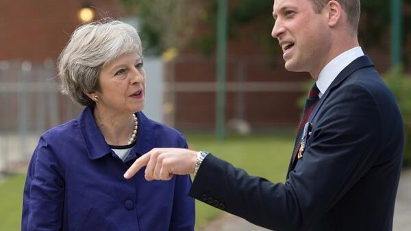 Britain's Prime Minister Theresa May (L) and Prince William (R) in Nottinghamshire, England on June 21, 2018.