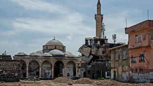 Damaged houses and a mosque in the historic district of Diyarbakir, southeastern Turkey