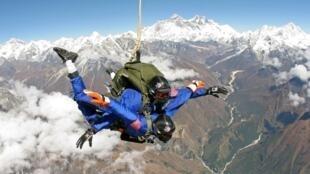 Skydivers free-fall north east of Kathmandu