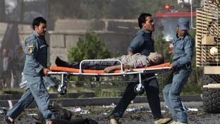 A casualty is carried away from the site of the attack on the British council in Kabul