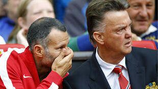 Manchester United manager Louis Van Gaal (right) with assistant coach Ryan Giggs, led the side to fourth in the Premier League last season.