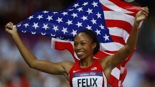 Allyson Felix of the US celebrates after winning the women's 200m final during the London 2012 Olympic Games