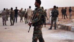 Quân đội chính phủ Syria tại căn cứ Tabqa ở vùng Raqqa, Syria, ngày 14/10/2019.
