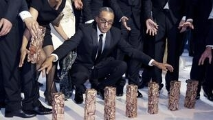Director Abderrahmane Sissako and his seven Césars awarded to him on Friday.