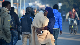 Migrants movoing out of the Jungle camp in Calais