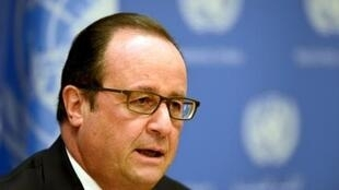 French President Francois Hollande announces the results of air strikes on Syria at the UN General Assembly in New York
