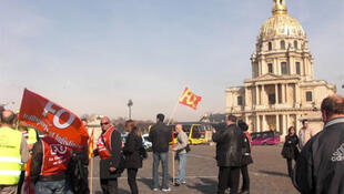 Public sector workers protest outside the Invalides monument in Paris, 23 March.