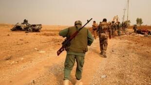 Combatentes peshmergas durante batalha contra o Estado Islâmico em Mossul, no Iraque, em foto de 24 de outubro de 2016.