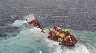 The stricken container ship Rena sits on a reef after splitting in two