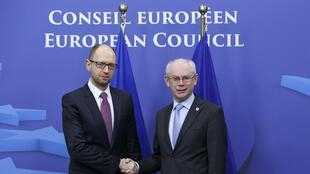 Ukraine's Prime Minister Arseniy Yatsenyuk (L) is welcomed by European Council President Herman Van Rompuy ahead of the Brussels emergency summit