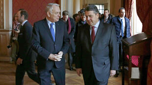 Jean-Marc Ayrault (L) escorts his newly appointed Germany counterpart Sigmar Gabriel before talks in Paris January 28.