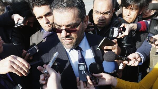 Anas al-Abdah, membre de la délégation de l'opposition syrienne, avant la première rencontre avec la délégation du régime depuis le débuit de la guerre, à Genève ce samedi 25 janvier.