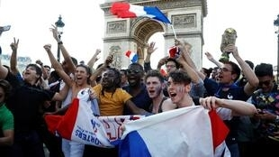 Crowds celebrate the French win on the Champs Elysées on Friday
