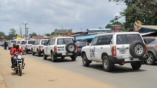 A column of UN cars belonging to the United Nations Mission in Liberia (UNMIL) leave Monrovia on March 30, 2018. Liberia's UN peacekeeping mission is departing after more than 14 years in the country.