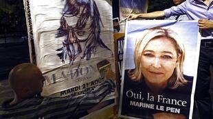 Front National supporters paste Marine Le Pen's face over posters advertising Madonna's Nice concert