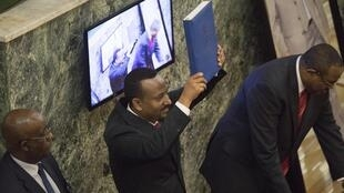 Abiy Ahmed, newly elected Prime Minister of Ethiopia, holds the Consitution of Ethiopia at the house of Parliament in Addis Ababa following the swearing in ceremony on 2 April 2018.
