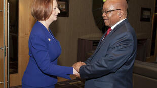 Australia's Prime Minister Julia Gillard shakes hands with South African President Jacob Zuma during a bi-lateral summit