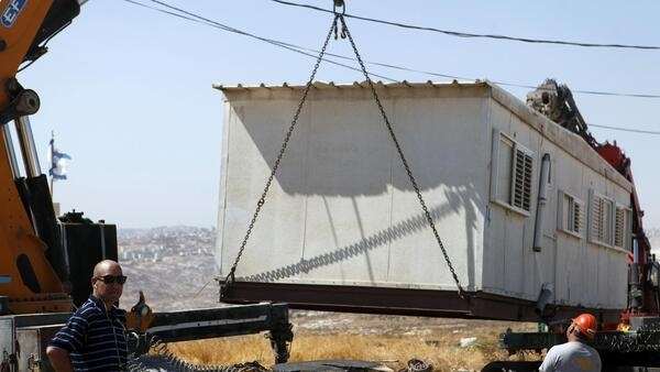 A structure is removed from the Migron outpost near the West Bank city of Ramallah, 5 September, 2012