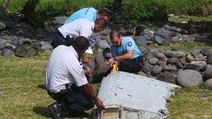 French police examine the debris from the Malaysia Airlines MH370 in July
