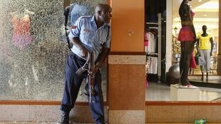 A police officer tries to secure an area inside the Westgate Shopping Centre
