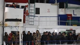 Migrants standing on the vessel Ezadeen at Corigliano Calabro harbor in southern Italy, 3 January  2015.