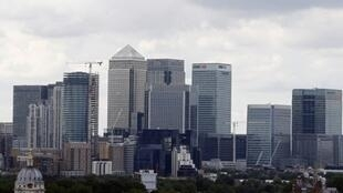 The Canary Wharf finance district of London, encompasing the offices of HSBC, Citigroup, JPMorgan Chase, Barclays, and other global banking corporations, is pitcured from Greenwich park in south-east London on June 26, 2016.