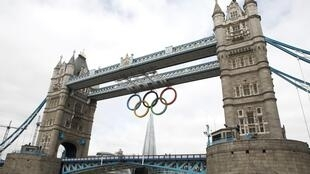 The Olympic Rings are seen hanging from Tower Bridge in London