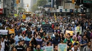 People march during a rally against climate change in New York, 21 September 2014.