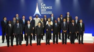 G8 leaders pose for the cameras at the end of the Deauville summit