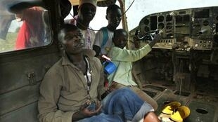 People living in an abandoned airplane at Bangui airport
