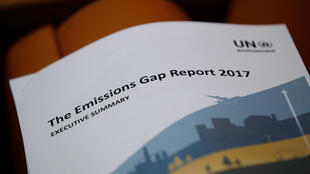 A copy of the report is pictured during the launch of the eighth edition of the UN Flagship Emissions Gap Report, days ahead of the convening of the UN Climate Change Conference (COP 23), at the United Nations in Geneva, Switzerland October 31, 2017