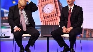 The two candidates for British prime minister Boris Johnson (l) next to Foreign Secretary Jeremy Hunt (r) during a TV debate Johnson did agree to onBBC, on 18 June 2019.
