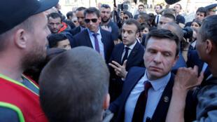 "French President Emmanuel Macron talks with people who oppose his reforms as he visits the ""Cœur de ville"" area in Saint-Die-des-Vosges, France, April 18, 2018."