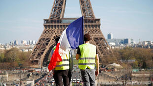 Yellow Vest protestors with French flag at Trocadéro opposite the Eiffel Tower in Paris, 30th March, 2019