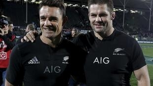 Dan Carter (left) and  skipper Richie McCaw celebrate after New Zealand's win over Argentina