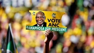 An ANC supporter holds a poster of Cyril Ramaphosa at a meeting of the ruling party in Johannesburg, 5 May 2019.
