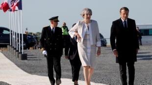 Theresa May and Emmanuel Macron at Ver-sur-Mer, Wed 6 June 2019.